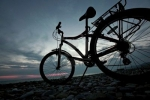 bicycle-life-the-bicycle-costs-on-stones-near-to-sea-coast-against-the-evening-sky
